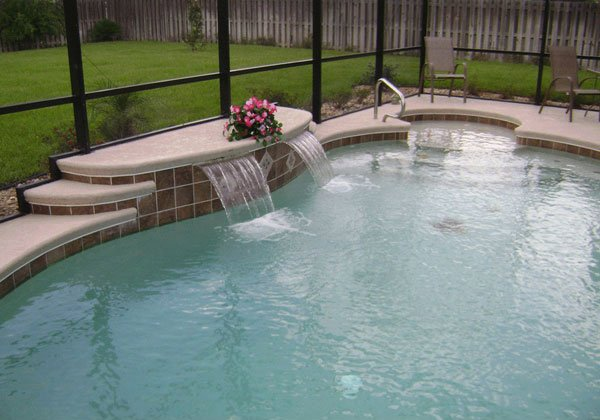 15 pool waterfalls ideas for your outdoor space home for Simple swimming pool designs