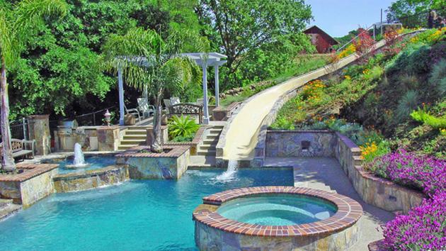 15 gorgeous swimming pool slides home design lover for Design hotel essen