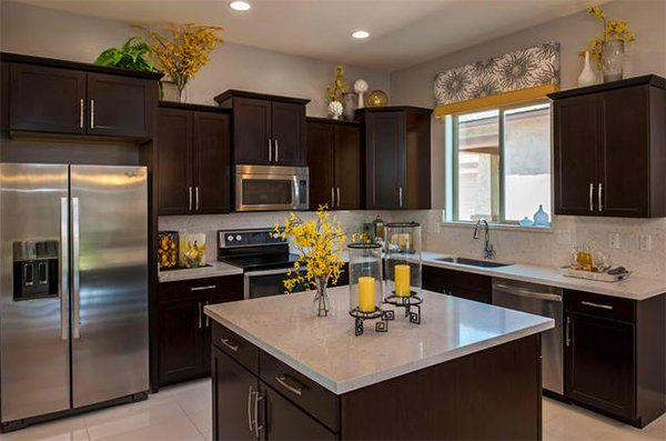 Put spaces between decors. How to Decorate the Top of Kitchen Cabinets   Home Design Lover