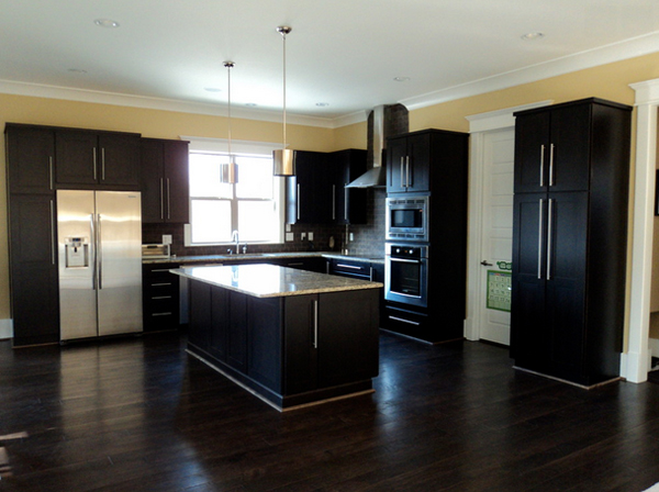 kitchens with dark cabinets and dark floors 2