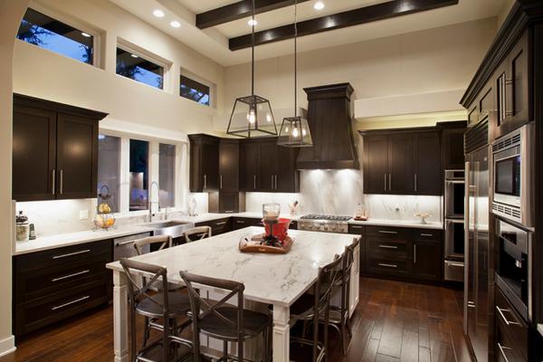 Dark Countertop Kitchen Goes Well With Bright Glass Backsplash