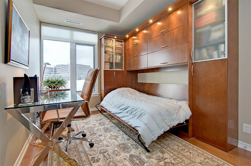 home office with hidden guest bed