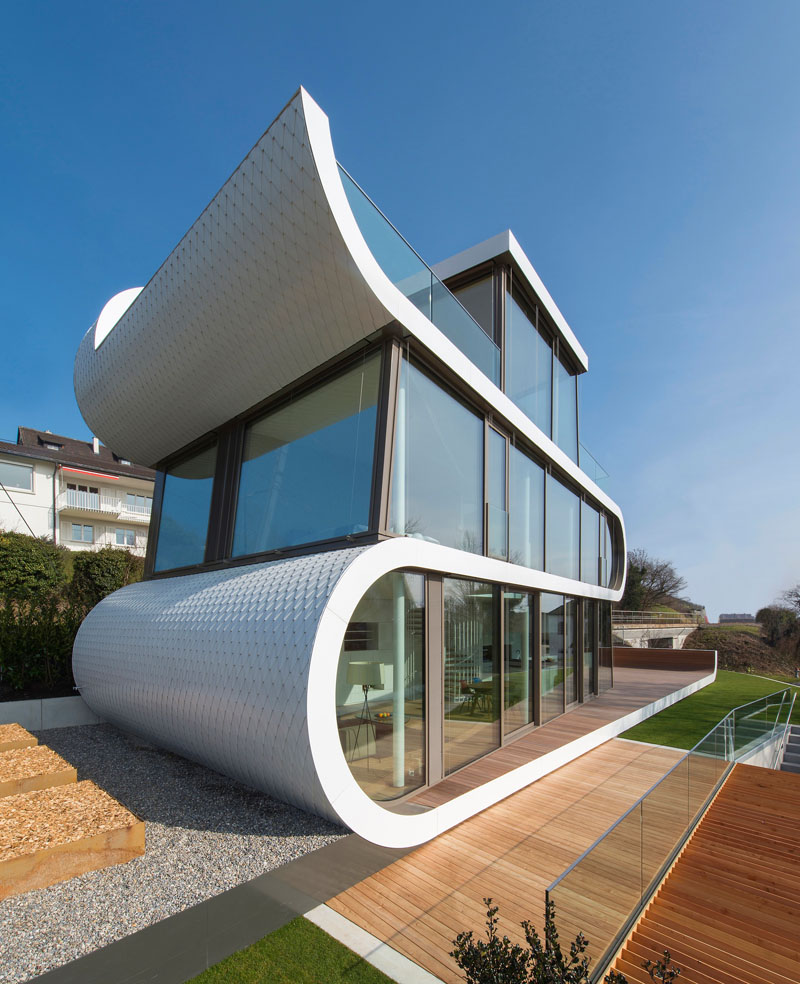 A white ribbons winds in the flex house of switzerland for Architecture suisse